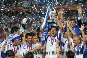 LISBON, PORTUGAL - JULY 4:  Traianos Dellas of Greece lifts the trophy during the UEFA Euro 2004 Final match between Portugal and Greece at the Luz Stadium on July 4, 2004 in Lisbon, Portugal. (Photo by Alex Livesey/Getty Images)